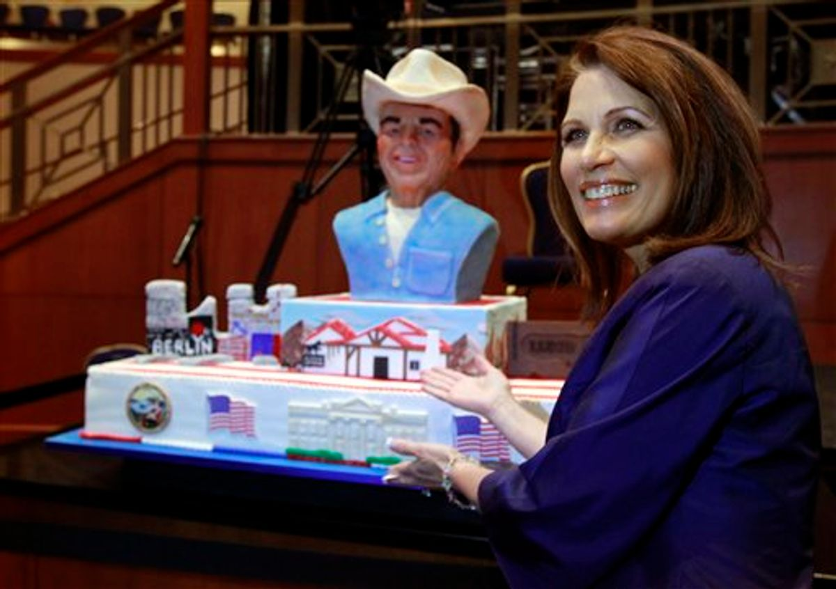 Rep. Michele Bachmann, R-Minn., poses for a picture with a birthday cake for President Ronald Reagan at the Conservative Political Action Conference (CPAC) in Washington, Thursday, Feb. 10, 2011.(AP Photo/Alex Brandon) (AP)