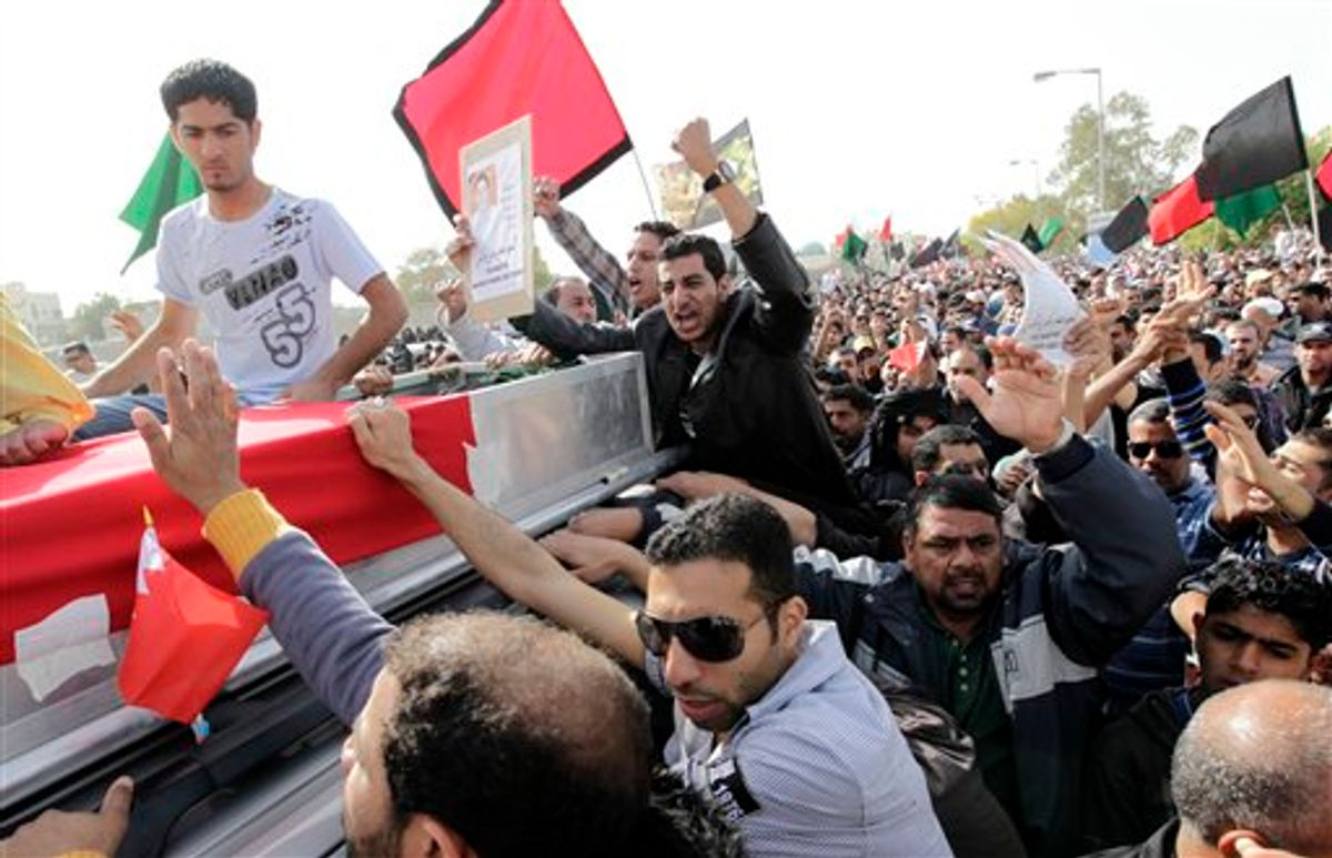 Friends and relatives chant anti-government slogans during the funeral of Mahmoud Maki Abu Taki, 22, who died during clashes between Bahraini anti-government protesters and riot police on Thursday, in Sitra village, Bahrain, Friday, Feb. 18, 2011. (AP Photo/Hassan Ammar) (AP)