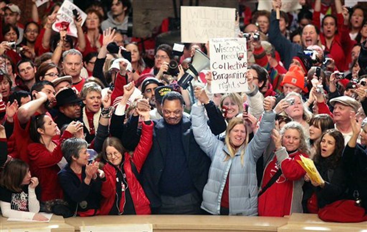 Jesse Jackson stands with protesters at the Capitol rotunda in Madison, Wis. on Friday, Feb.  17, 2011.  Union members, students and others have been protesting the governor's bill to eliminate collective bargaining rights for many state workers.  (AP Photo/Wisconsin State Journal, Craig Schreiner) (AP)