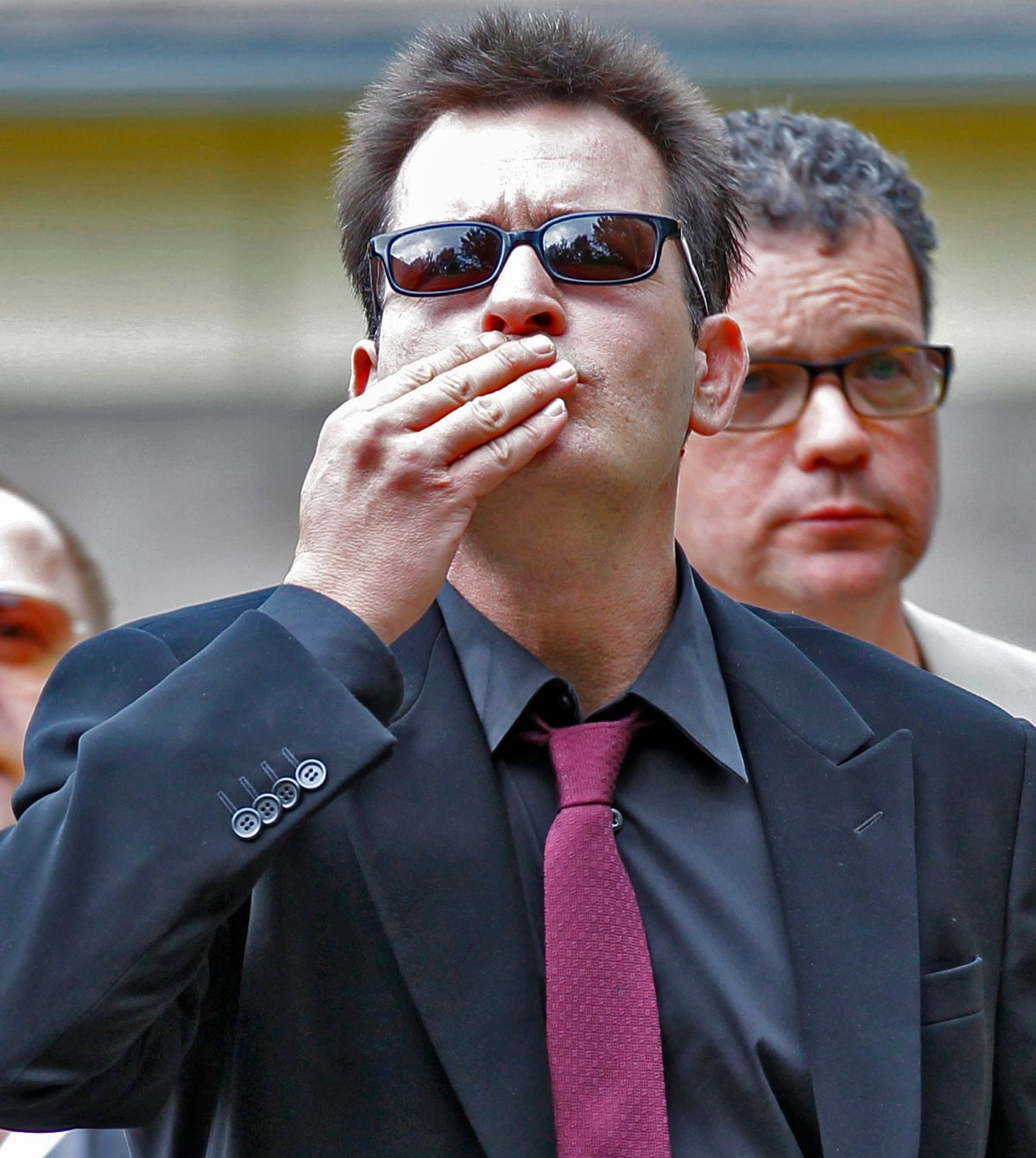 Charlie Sheen gestures with a victory sign as he arrives at the Pitkin County Courthouse in Aspen, Colo., on Monday, Aug 2, 2010, for a hearing in his domestic abuse case. (AP Photo/Ed Andrieski (Ed Andrieski)