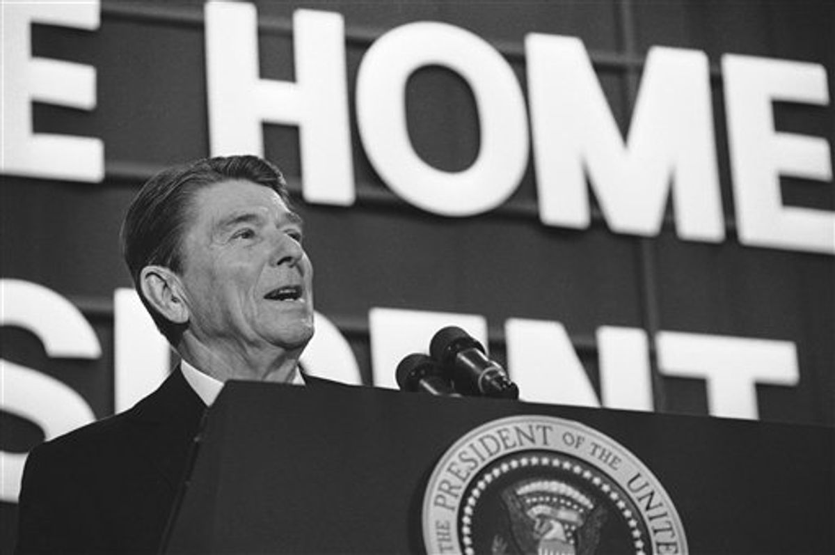 FILE - In this Feb. 7, 1984 file photo, President Ronald Reagan addresses a crowd of well-wishers gathered for a huge birthday party in the Dixon High School gymnasium in Dixon, Ill. Reagan returned to his boyhood home for the first time since becoming president to celebrate his 73rd birthday. Reagan was born 100 years ago Sunday, Feb. 6, 2011. (AP Photo/Dennis Cook, File) (AP)