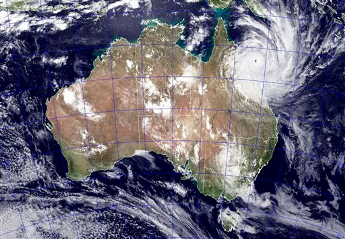 This image provided by NASA shows Tropical Cyclone Yasi as it approaches Queensland, Australia, Wednesday Feb. 2, 2011. This NEXSAT image captured this natural-color image at 04:32 GMT Wednesday Feb. 2, 2011. The Category 5 storm is expected to make landfall at approximately noon GMT Wednesday. Gusts up to 186 mph (300 kph) were expected when Cyclone Yasi strikes the Australian coast Wednesday after whipping across Australia's Great Barrier Reef. The storm front is more than 310 miles (500 kilometers) wide and Yasi is so strong, it could reach far inland before it significantly loses power. (AP Photo/NASA - Jeff Schmaltz) (AP)
