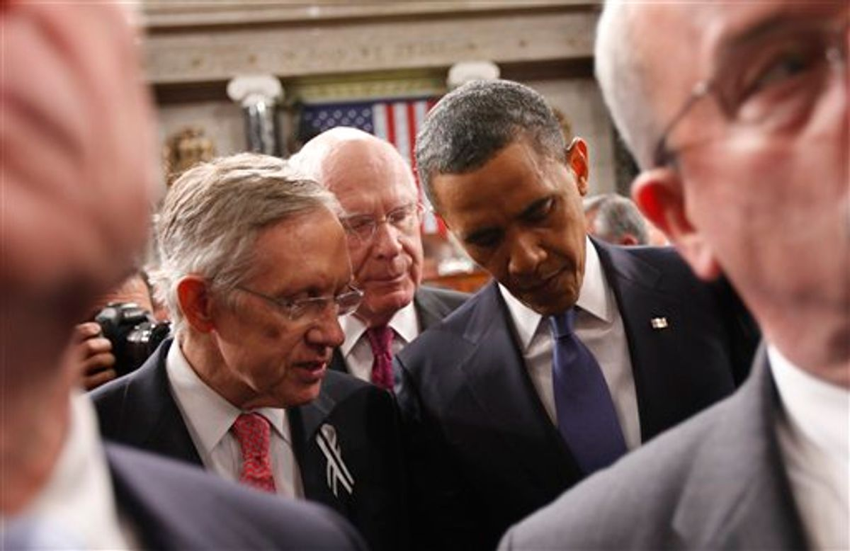 President Barack Obama talks with Senate Majority Leader Harry Reid of Nev., left, and Sen. Patrick Leahy, D-Vt., on Capitol Hill in Washington, Tuesday, Jan. 25, 2011, after delivering his State of the Union address.  (AP Photo/Pablo Martinez Monsivais, Pool)     (AP)