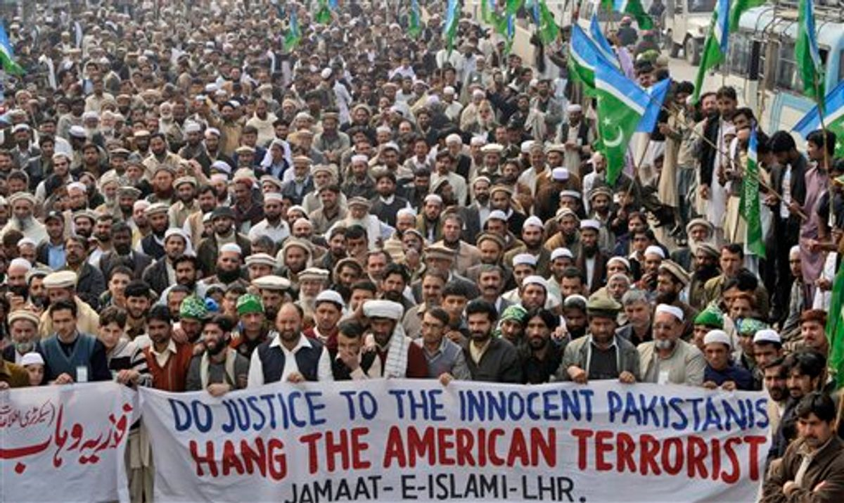 Supporters of Pakistani religious party Jamat-e-Islami attend a rally against Raymond Allen Davis, a U.S. consulate employee suspected in a shooting, in Lahore, Pakistan, Tuesday, Feb. 15, 2011. Most legal experts in Pakistan's government believe an American detained in the killing of two Pakistanis has diplomatic immunity, but a court should decide his fate, an official said Tuesday. The announcement reflected an apparent bid to open the way to the man's release while dampening public outrage. (AP Photo/K.M. Chaudary) (AP)