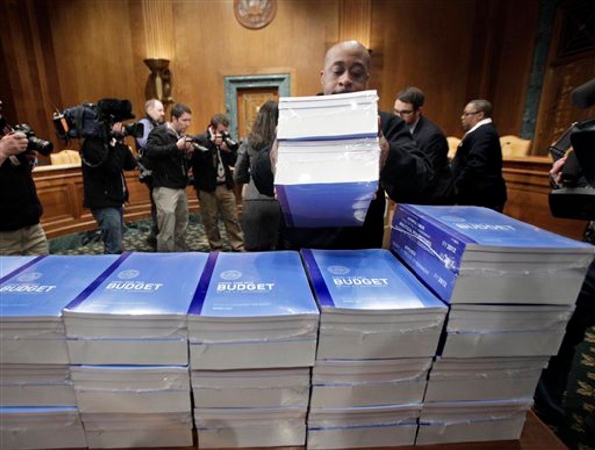 Copies of President Obama's 2012 budget are delivered to the Senate Budget Committee, Monday, Feb. 14, 2011, on Capitol Hill in Washington.  (AP Photo/J. Scott Applewhite) (AP)