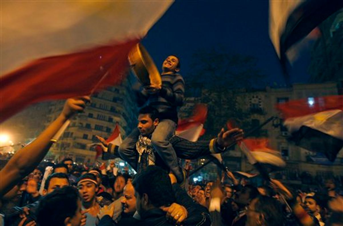 Demonstrators celebrate in Tahrir Square in Cairo, Egypt, Friday Feb. 18, 2011. Tens of thousands of flag-waving Egyptians packed into Tahrir Square for a day of prayer and celebration Friday to mark the fall Hosni Mubarak a week ago and to maintain pressure on the new military rulers to steer the country toward democratic reforms.(AP Photo/Khalil Hamra) (AP)