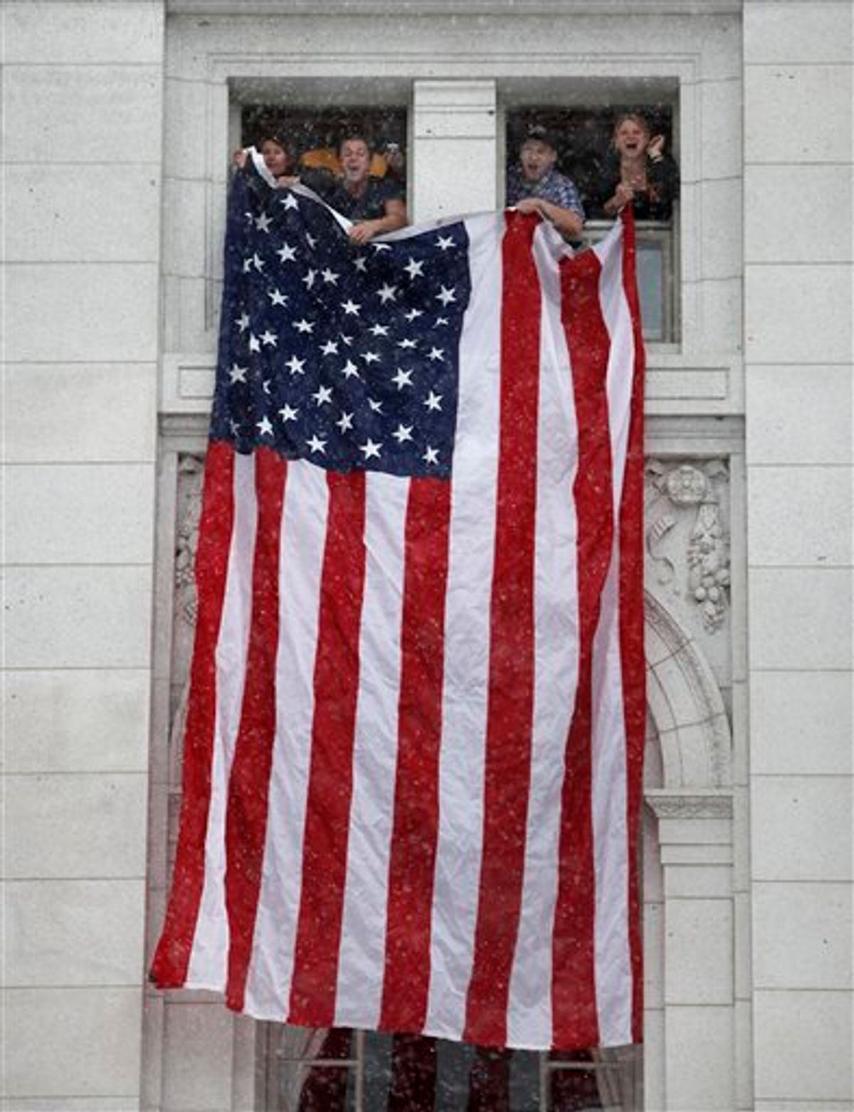 Rally supporters hang an American flag from fourth floor windows of the Wisconsin State Capitol Building as thousands of opponents of Governor Scott Walker's budget repair bill gather for ongoing protests inside and outside the State Capitol Building in Madison, Wisconsin Saturday, February 26, 2011. (AP Photos/Wisconsin State Journal, John Hart) (AP)