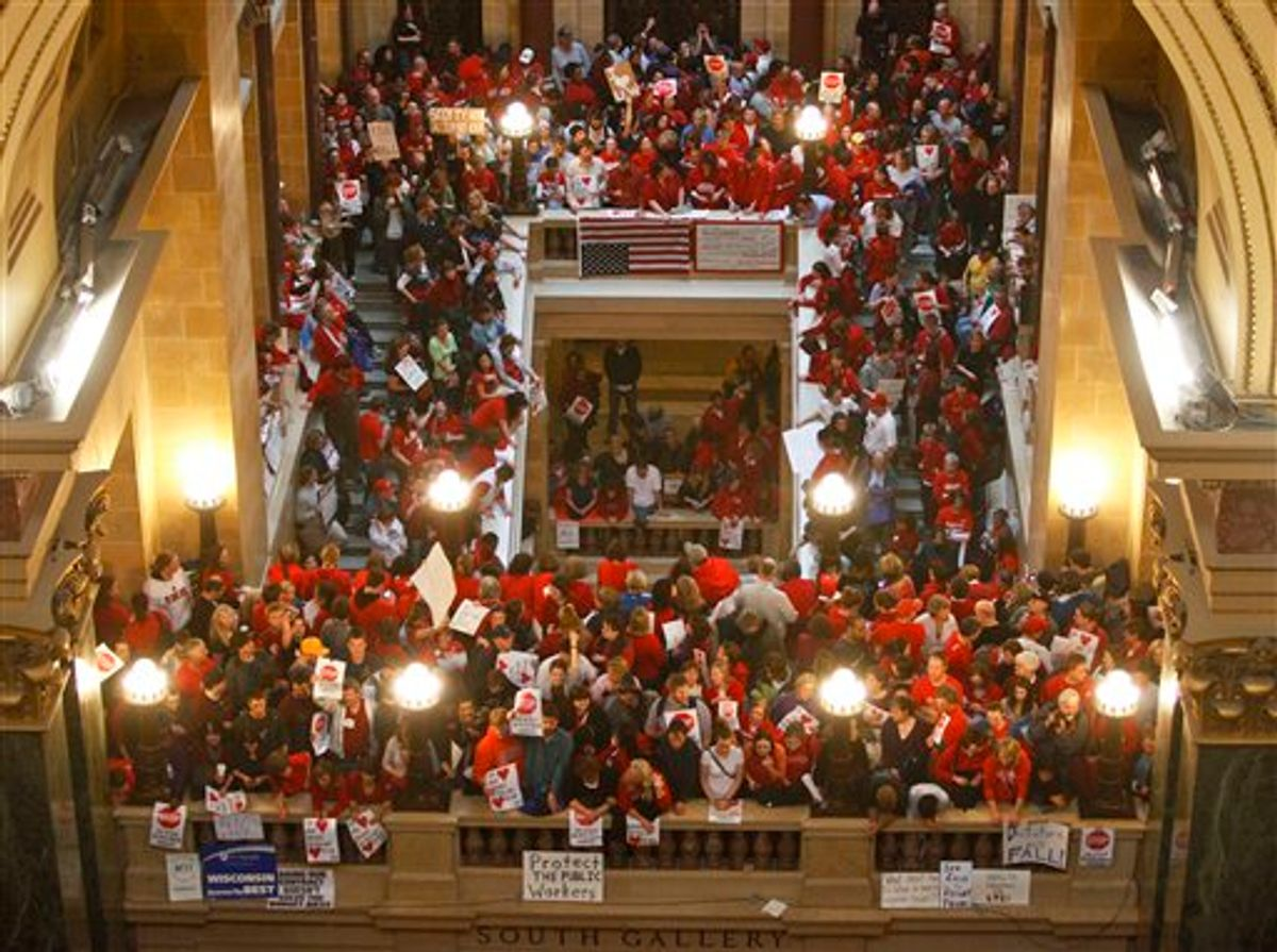 Protestors to Wisconsin Gov. Scott Walker's bill to eliminate collective bargaining rights for many state workers pack the rotunda at the State Capitol in Madison, Wis., Thursday, Feb. 17, 2011. (AP Photo/Andy Manis) (AP)
