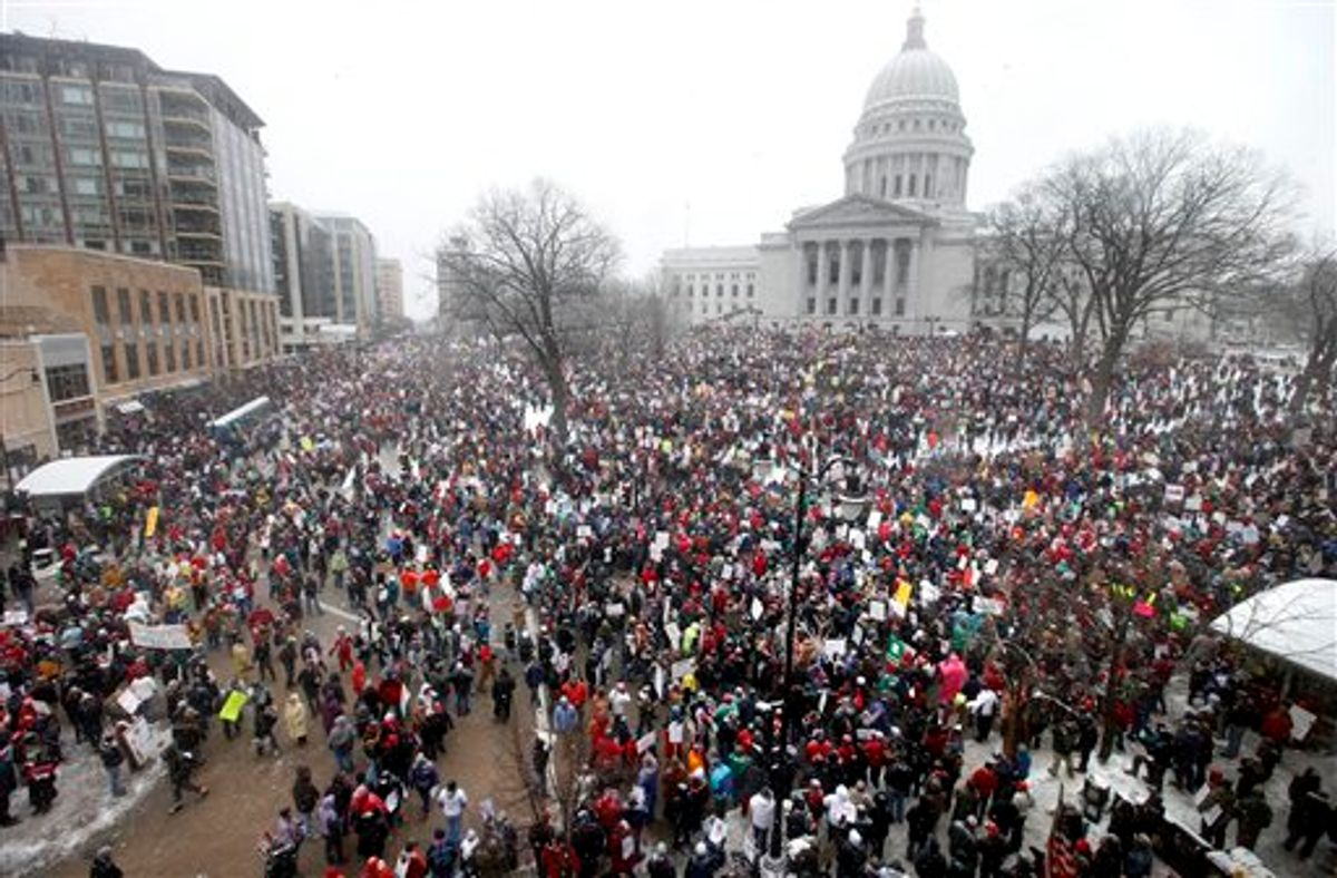 Thousands of opponents of Wisconsin Wisconsin Governor Scott Walker's budget repair bill gather for protests at the Wisconsin State Capitol in Madison, Wisconsin Saturday, February 26, 2011. (AP Photo/Wisconsin State Journal, John Hart) (AP)