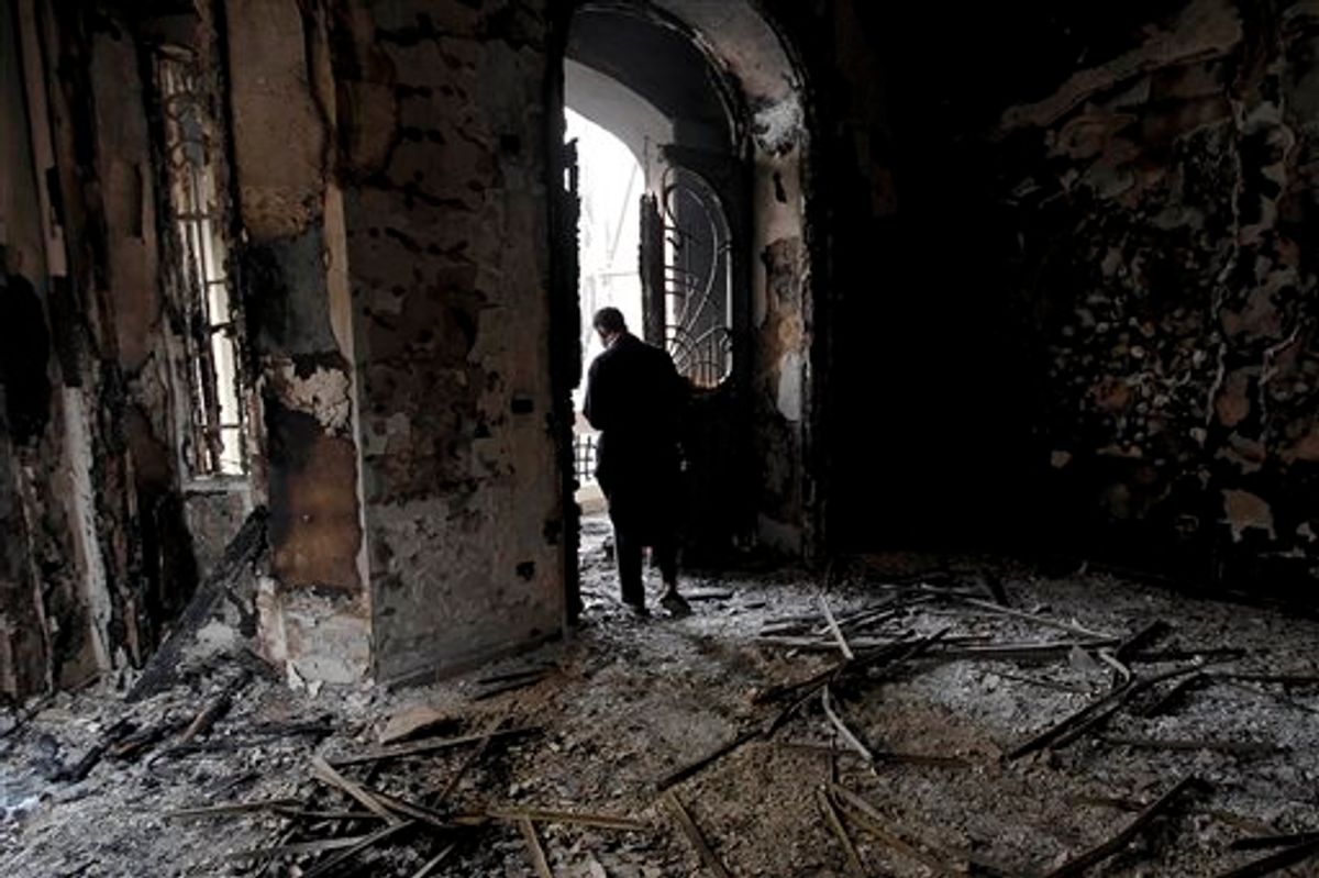An Egyptian man surveys the fire damage at a burned and looted police station, in the Darb al Ahmar neighborhood of Cairo, Egypt, Saturday, Jan. 29, 2011. (AP Photo/Tara Todras-Whitehill)  (AP)