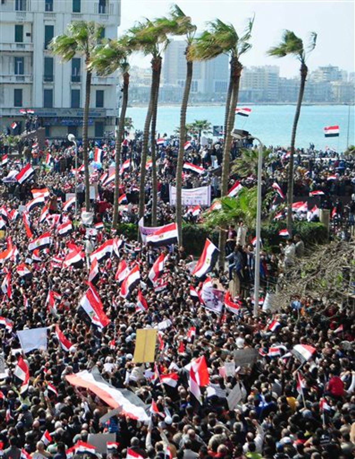 Thousands of Egyptian anti-government protesters march Alexandria, Egypt, Friday, Feb. 11, 2011. Egypt's military threw its weight Friday behind President Hosni Mubarak's plan to stay in office through September elections while protesters fanned out to the presidential palace in Cairo and other key symbols of the authoritarian regime in a new push to force the leader to step down immediately. The statement by the Armed Forces Supreme Council - its second in two days - was a blow to many protesters who had called on the military to take action to push out Mubarak after his latest refusal to step down. (AP Photo/ Tarek Fawzy) (AP)