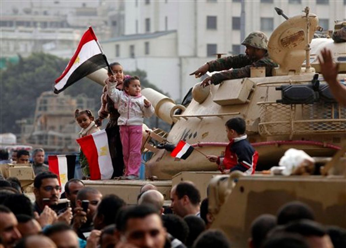 Young girls wave Egyptian flags atop an armored vehicle just outside Tahrir or Liberation Square in Cairo, Egypt, Tuesday, Feb. 1, 2011. More than a quarter-million people flooded into the heart of Cairo Tuesday, filling the city's main square in by far the largest demonstration in a week of unceasing demands for President Hosni Mubarak to leave after nearly 30 years in power. (AP Photo/Victoria Hazou) (AP)