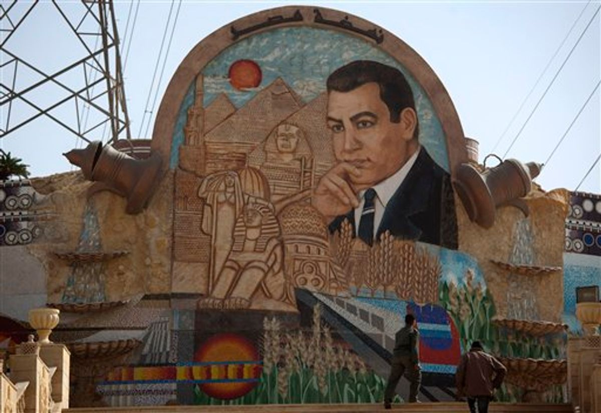 An Egyptian soldier walks up steps next to a stone mural with an image depicting former Egyptian President Hosni Mubarak on the outskirts of Cairo, Egypt, Tuesday Feb. 15, 2011.  On Tuesday, the Armed Forces Supreme Council said a panel of experts would craft constitutional amendments to allow free elections later this year. (AP Photo/Emilio Morenatti) (AP)