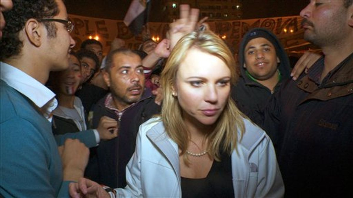 """In this Feb. 11, 2011 photo released by CBS, """"60 Minutes"""" correspondent Lara Logan is shown covering the reaction in in Cairo's Tahrir Square the day Egyptian President Hosni Mubarak stepped down.  CBS News says Logan was attacked Friday, and suffered a brutal beating and sexual assault before being saved by a group of women and an estimated 20 Egyptian soldiers. She is recovering in a U.S. hospital. Logan, CBS News' chief foreign affairs correspondent, is one of at least 140 correspondents who have been injured or killed since Jan. 30 while covering the unrest in Egypt, according to the Committee to Protect Journalists.  (AP Photo/CBS News)   (AP)"""