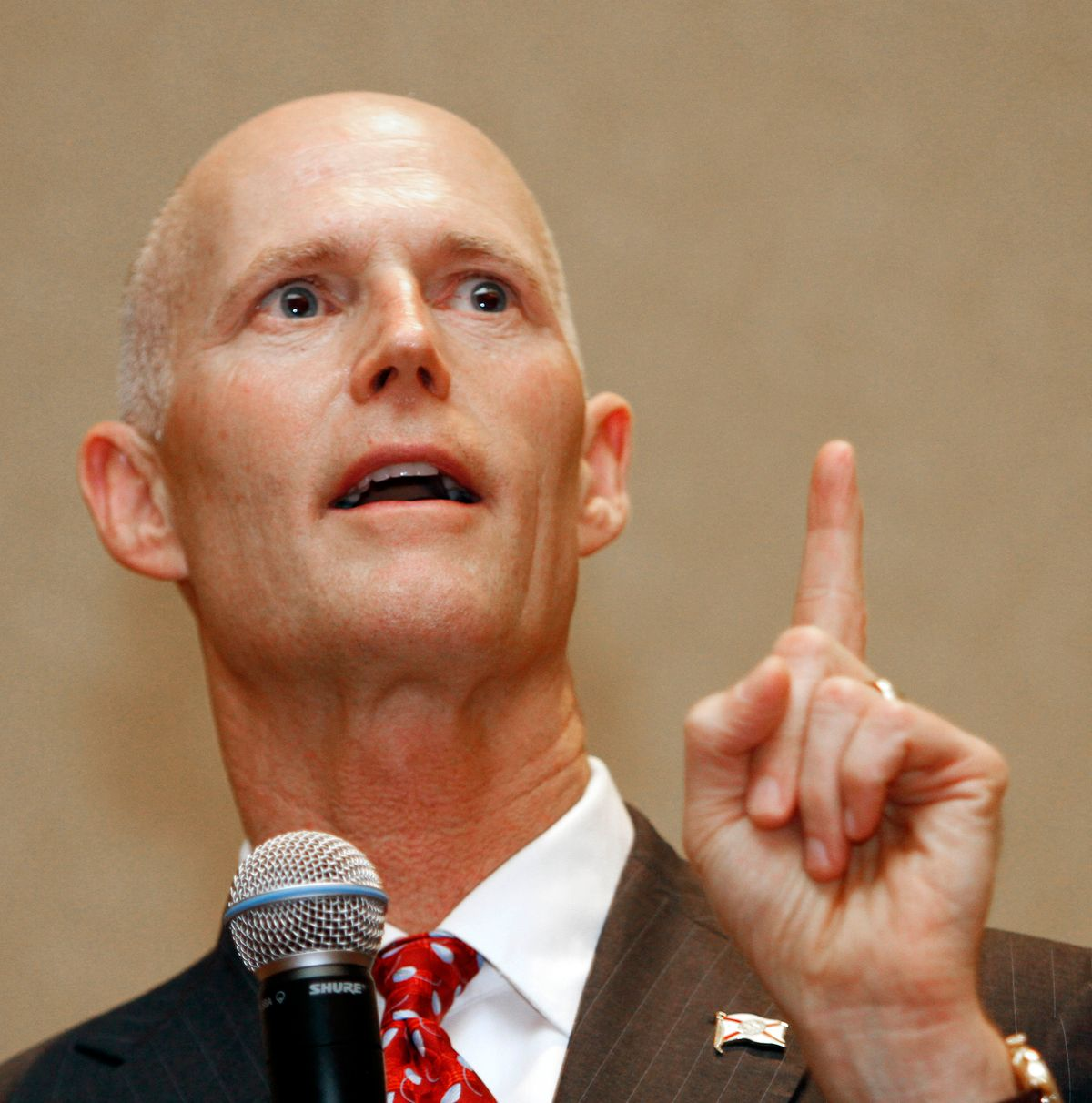 Gov. Rick Scott gestures during a  business conference in Hollywood, Fla., Friday, Feb. 4, 2011. (AP Photo/Alan Diaz)