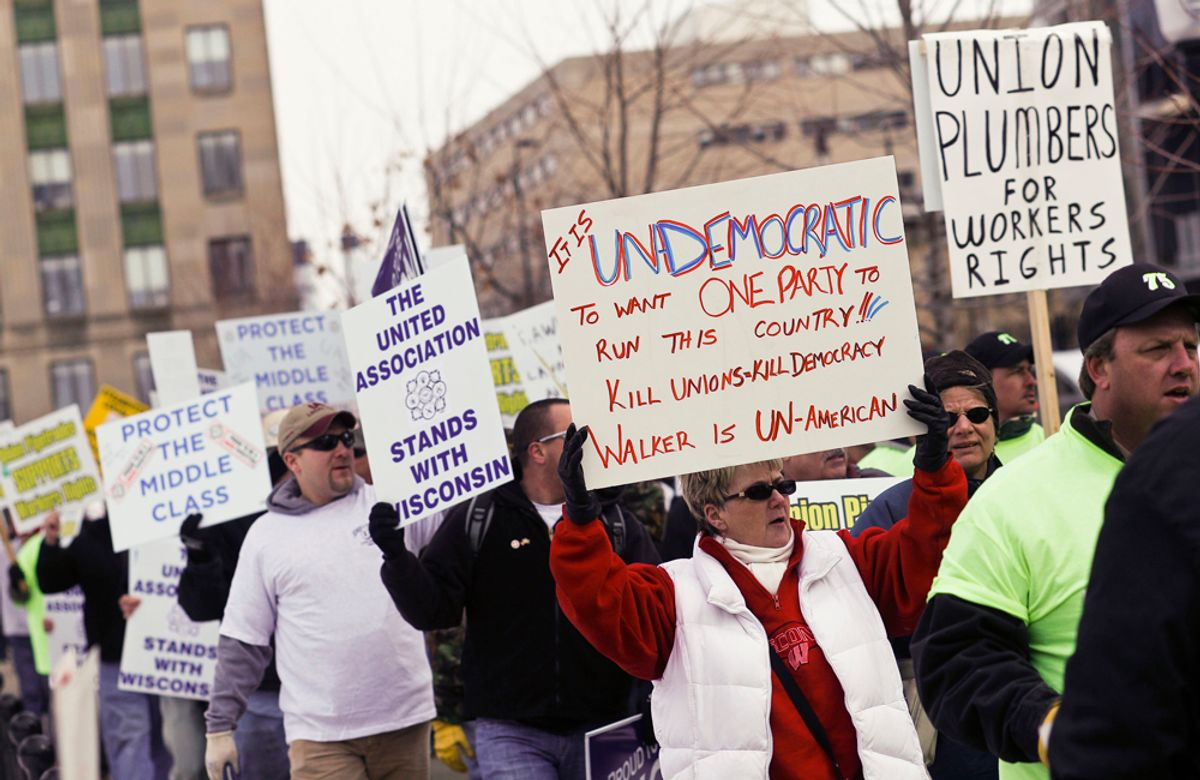 Protesters march around the Capitol Square in Madison, Wis., Friday, Feb. 25, 2011, over the governor's proposed budget. Protests to the governor's bill to eliminate collective bargaining rights for many state workers are in their 11th day. (AP Photo/Andy Manis) (Andy Manis)