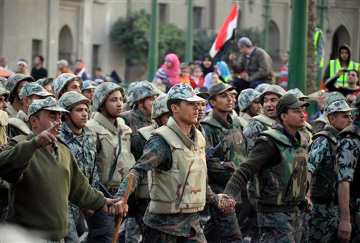 Egyptian army soldiers inside Tahrir Square, Egypt, Saturday, Feb. 12, 2011. The main coalition of youth and opposition groups says it will end its protest in a central Cairo square after they succeeded in ousting longtime authoritarian leader Hosni Mubarak. But the groups say they will call for weekly demonstrations to maintain pressure on the ruling military to implement democratic reforms. (AP Photo/Amr Nabil) (AP)