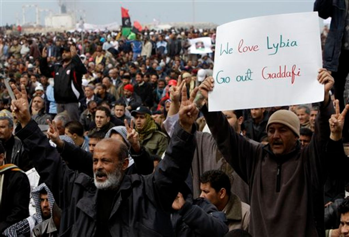 Libyan protesters shout slogans against Libyan Leader Moammar Gadhafi during a demonstration at the court square, in Benghazi, Libya, on Friday Feb. 25, 2011. Several tens of thousands held a rally in support of the Tripoli protesters in the main square of Libya's second-largest city, Benghazi, where the revolt began, about 580 miles (940 kilometers) east of the capital along the Mediterranean coast. (AP Photo/Hussein Malla) (AP)