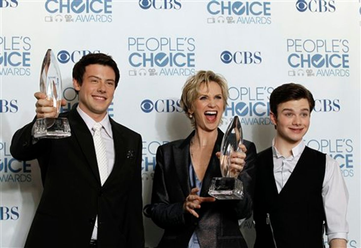 """From left, Cory Monteith, Jane Lynch, and Chris Colfer pose for a photo backstage with the award for favorite TV comedy for """"Glee"""" at the People's Choice Awards on Wednesday, Jan. 5, 2011, in Los Angeles. (AP Photo/Matt Sayles)    (AP)"""