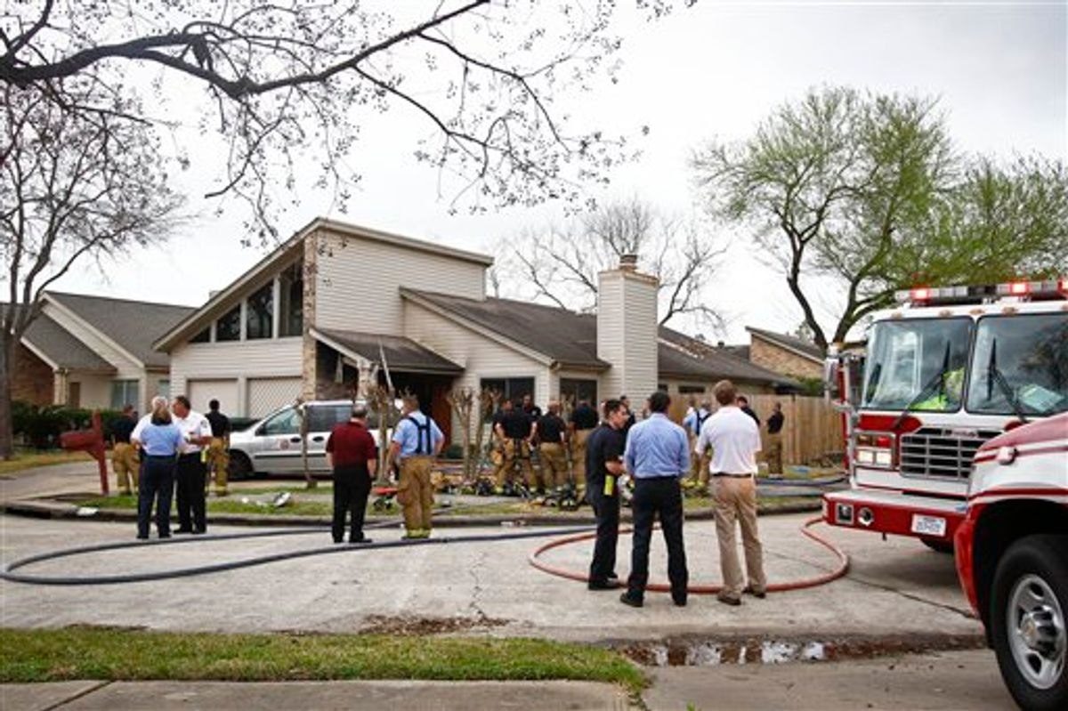 Emergency Personnel respond to the location where a fire broke out at a day care operated by Jessica Tata, 22,  lkilling three children and injuring four others Thursday, Feb. 24, 2011, in Houston. (AP Photo/Houston Chronicle, Michael Paulsen) MANDATORY CREDIT (AP)