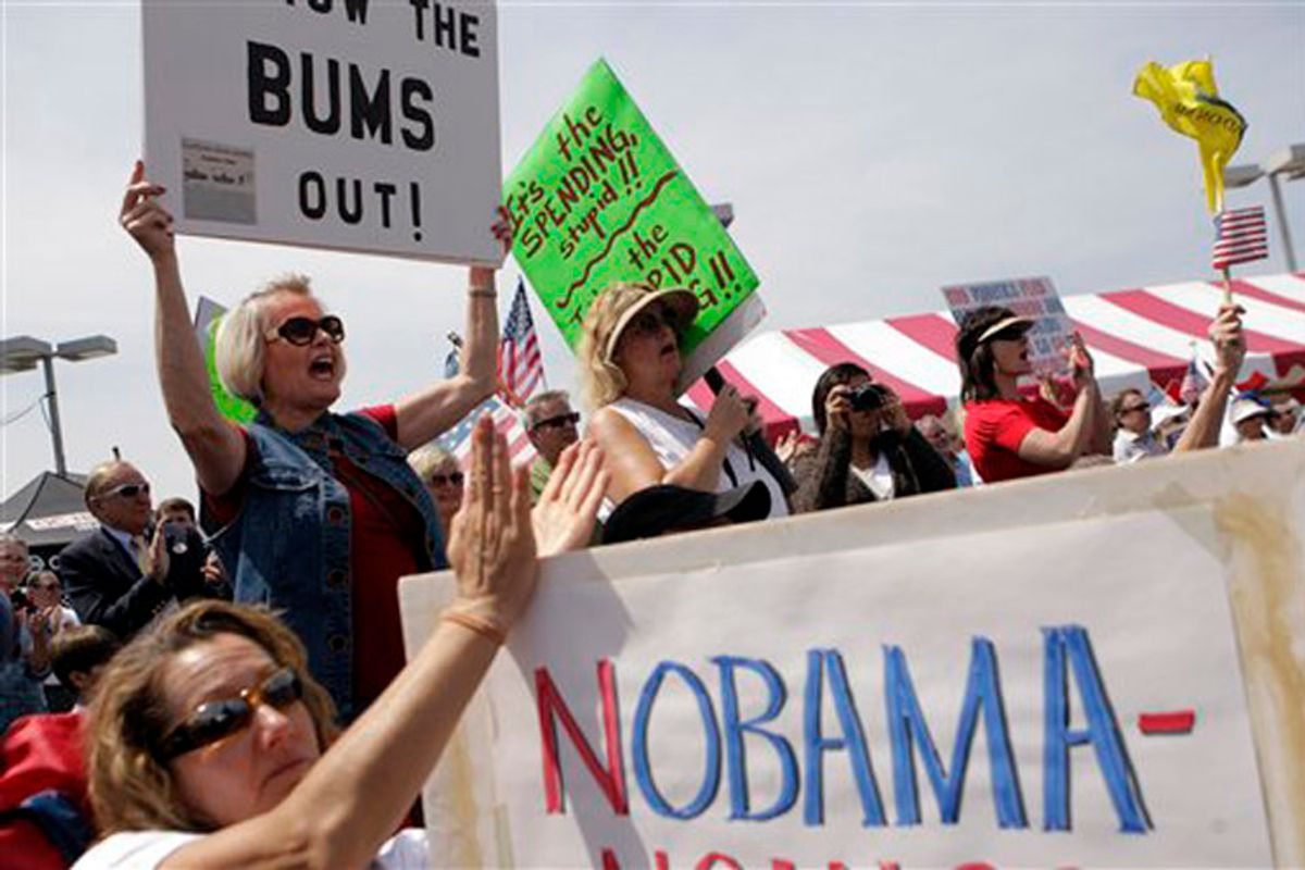 Tea party supporters cheer as they listen to a speech at a tea party rally in Irvine, Calif., Thursday, April 15, 2010. (AP Photo/Jae C. Hong) (Jae C. Hong)