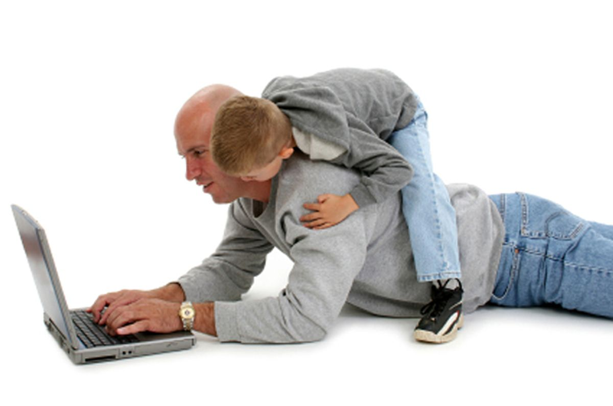 Four year old boy on his father's back while working on laptop. Shot over white.    (Jaimie D. Travis)