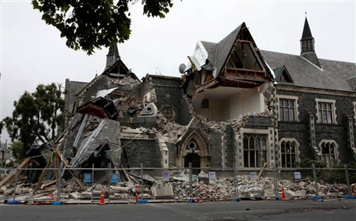 A building in Christchurch, New Zealand, is destroyed after an earthquake struck Tuesday, Feb. 22, 2011. The 6.3-magnitude quake collapsed buildings and is sending rescuers scrambling to help trapped people amid reports of multiple deaths. (AP Photo/NZPA, Pam Johnson) NEW ZEALAND OUT, NO ARCHIVES, NO SALES  (AP)
