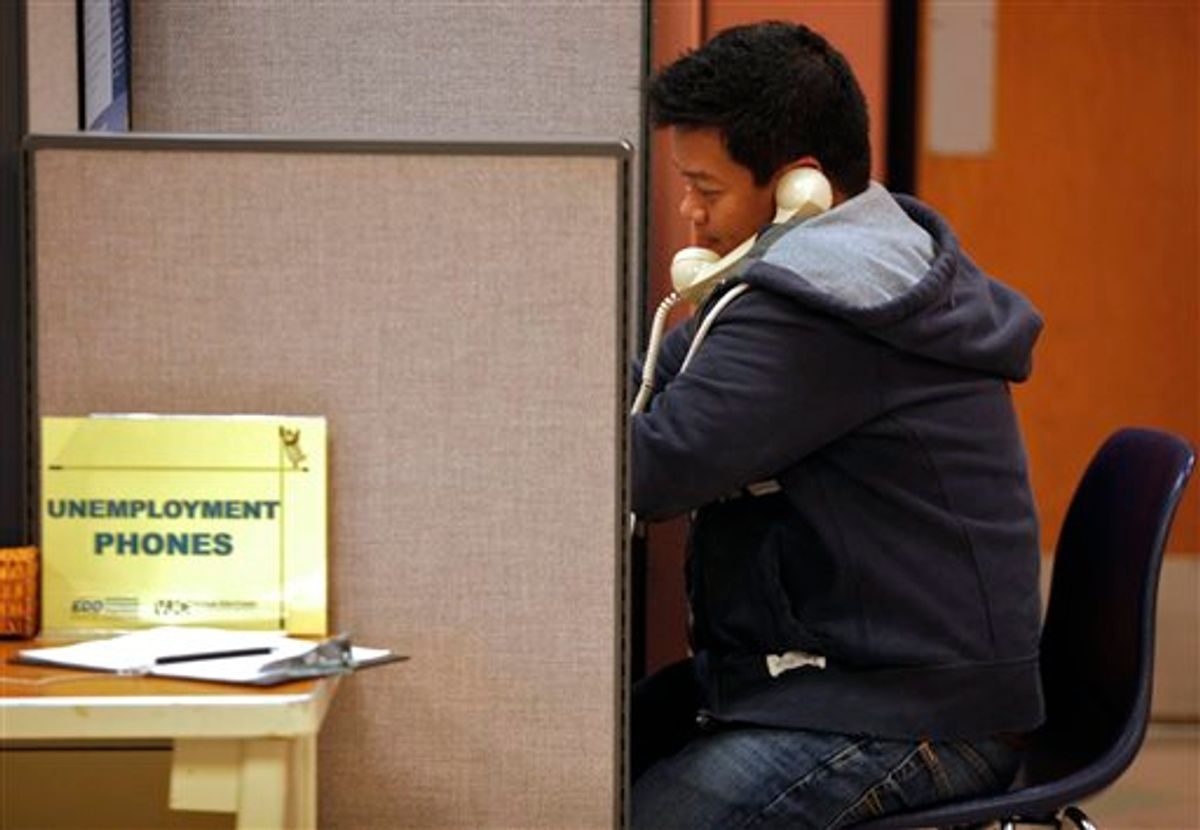 In this photo taken Feb. 3, 2011, unemployed financial worker Jonathan Velazquez, phones in to get State of California's Employment Development Department,  EDD unemployment benefits at the Verdugo Job Center in Glendale, Calif. Finding a job remains a struggle 20 months after the recession technically ended. (AP Photo/Damian Dovarganes) (AP)