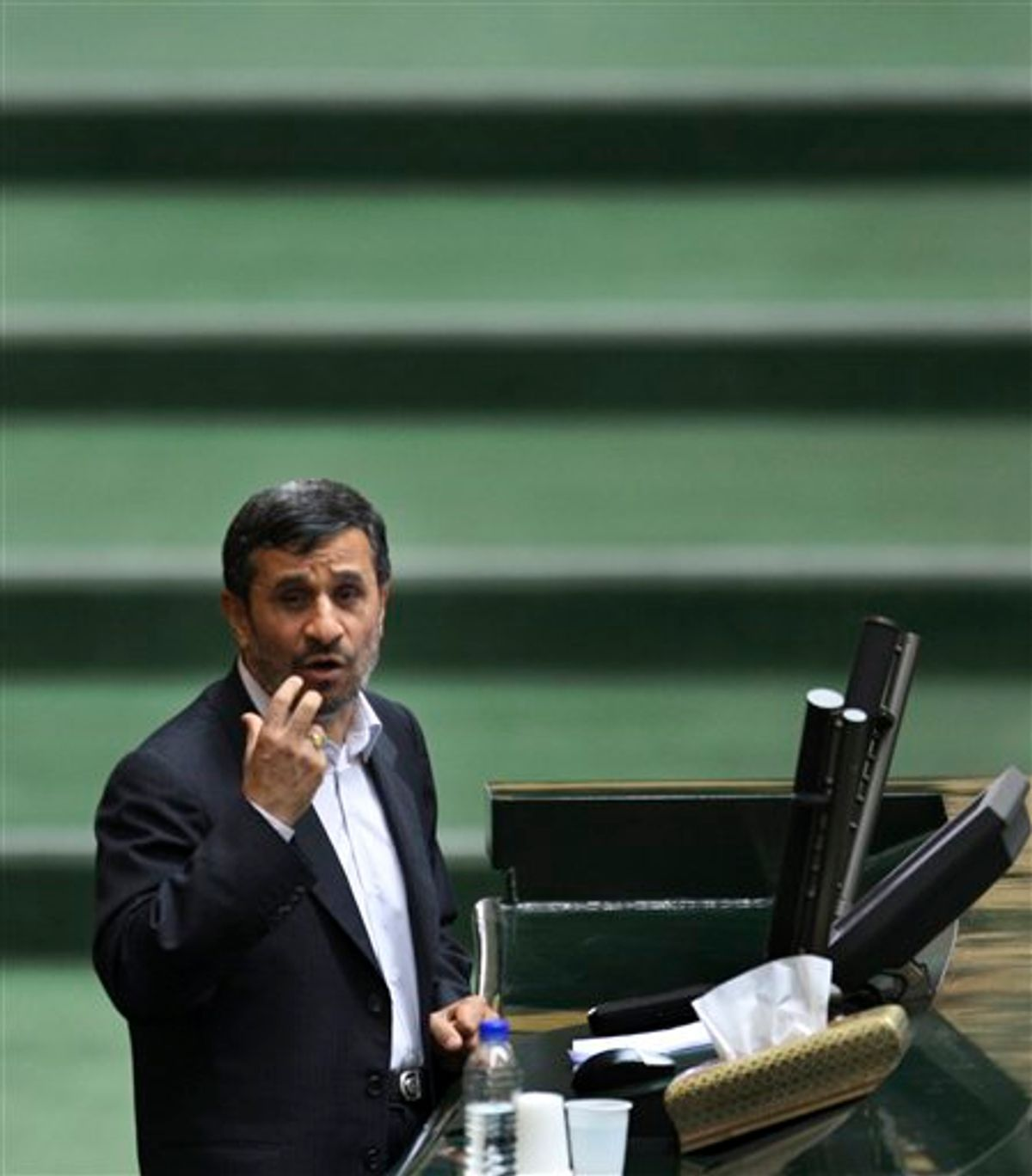 Iranian President Mahmoud Ahmadinejad delivers his speech during the debate for a vote of confidence in Ahmadinejad's choice for new Foreign Minister, who is Head of Iran's Atomic Energy Organization, Ali Akbar Salehi,  during an open session of parliament, in Tehran, Iran, Sunday, Jan. 30, 2011.  Iran's lawmakers approved Ahmadinejad's choice of Salehi for foreign minister, indicating the importance that the country's nuclear program has for its international diplomacy. (AP Photo/Vahid Salemi) (AP)