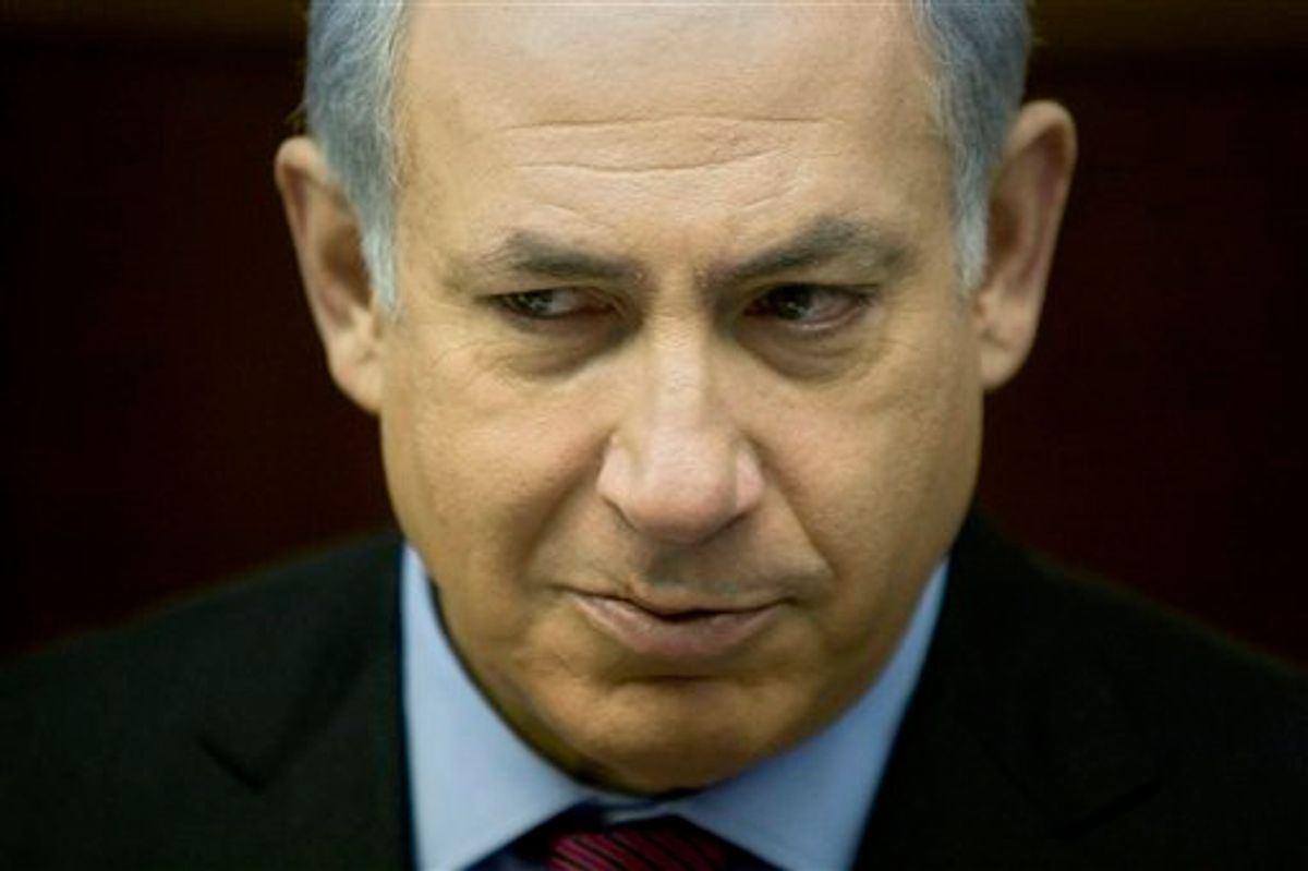 Israeli Prime Minister Benjamin Netanyahu attends the weekly cabinet meeting in his Jerusalem office, Sunday, Jan. 16, 2011. Israeli authorities said Sunday they are moving ahead with a new proposal to build 1,400 apartments in a contested part of Jerusalem, enraging Palestinians who denounced the plan as another settler land grab. (AP Photo/Sebastian Scheiner, Pool)  (AP)