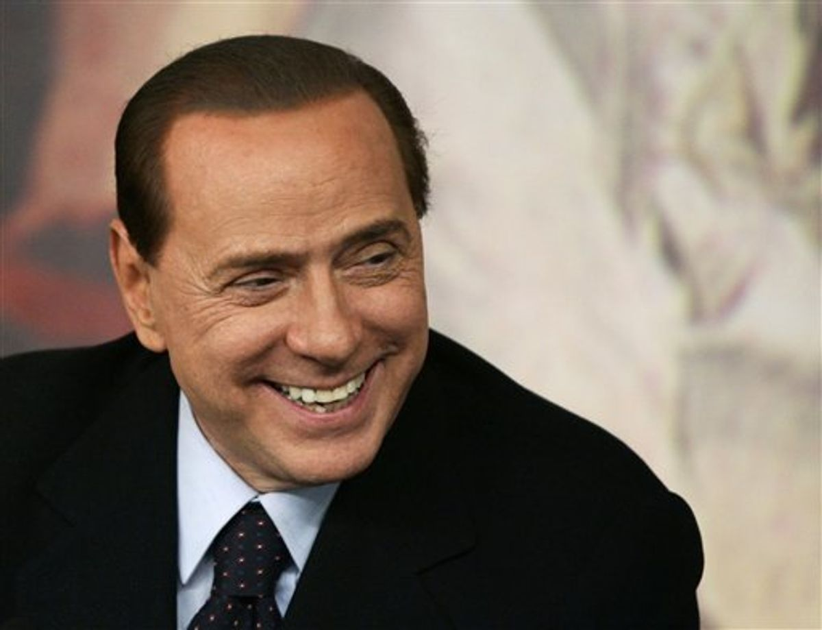 Italian Premier Silvio Berlusconi smiles during a press conference at Chigi Premier's palace, in Rome, Wednesday, Feb. 16, 2011. Berlusconi says he is not worried by an impending prostitution trial, in his first public comments since he was indicted. The 74-year-old Italian leader was ordered Tuesday to stand trial on charges he paid a 17-year-old Moroccan girl for sex, and then used his influence to cover it up. (AP Photo/Riccardo De Luca)        (AP)