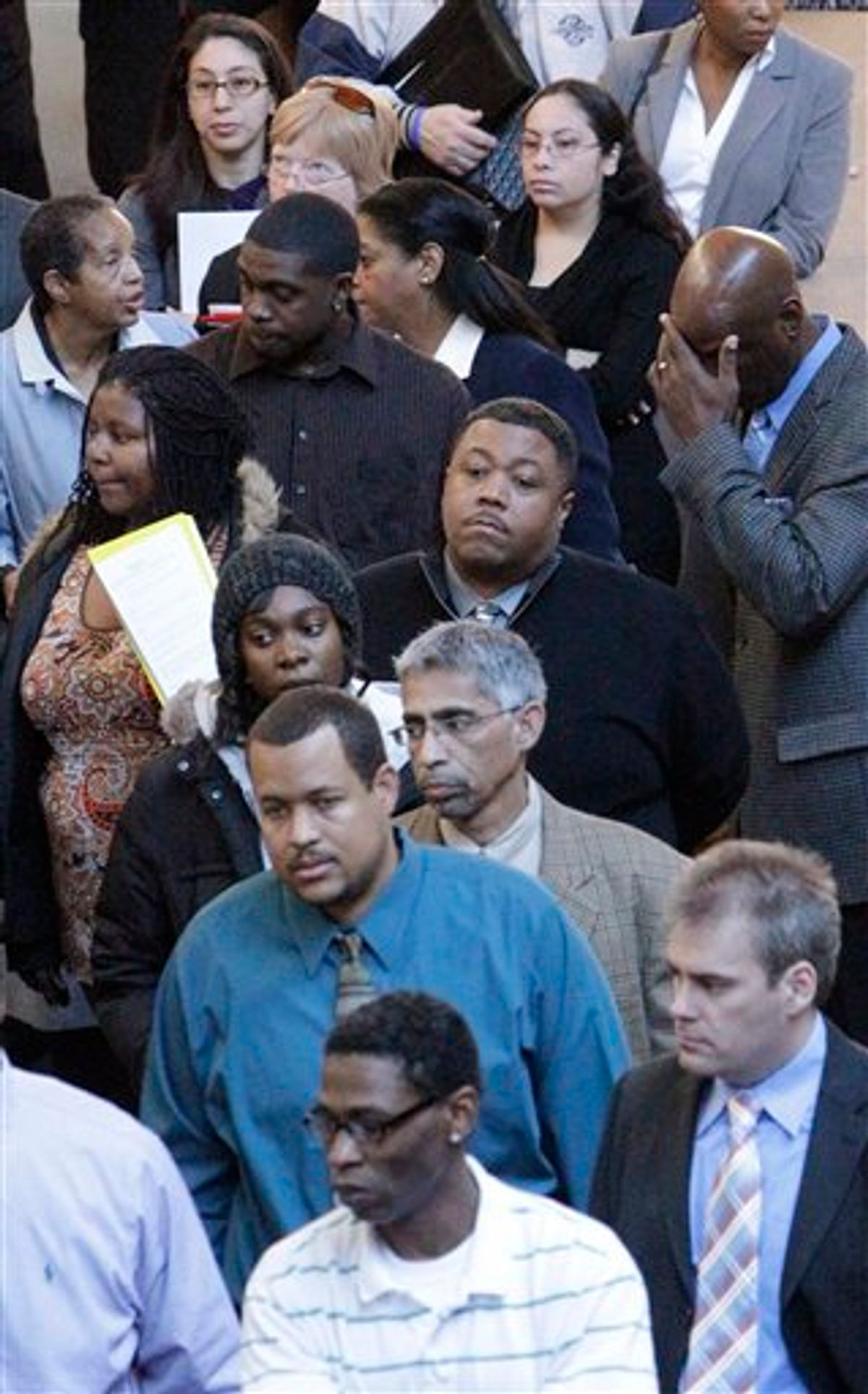 FILE - In this Jan. 26, 2011 file photo, job seekers line up for a job fair at a hotel in Dallas. The number of people applying for unemployment benefits fell last week, after bad weather contributed to a spike in the number of those seeking benefits the previous week. (AP Photo/LM Otero, file) (AP)