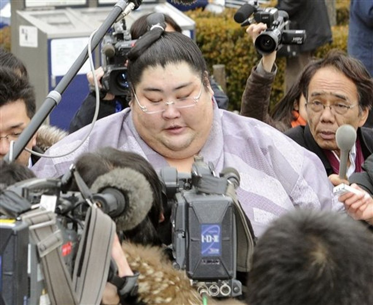 Sumo wrestler Yamamotoyama is surrounded by Japanese reporters after he was questioned by sumo elders in an emergency meeting at the Ryogoku Kokugikan sumo arena in Tokyo on Wednesday Feb. 2, 2011. Fresh off a gambling scandal that deeply sullied its image, Japan's national sport of sumo wrestling is now grappling with allegations that senior wrestlers and coaches used cell phones to plan how to fix bouts. (AP Photo/Kyodo News) JAPAN OUT, CREDIT MANDATORY, FOR COMMERCIAL USE ONLY IN NORTH AMERICA (AP)