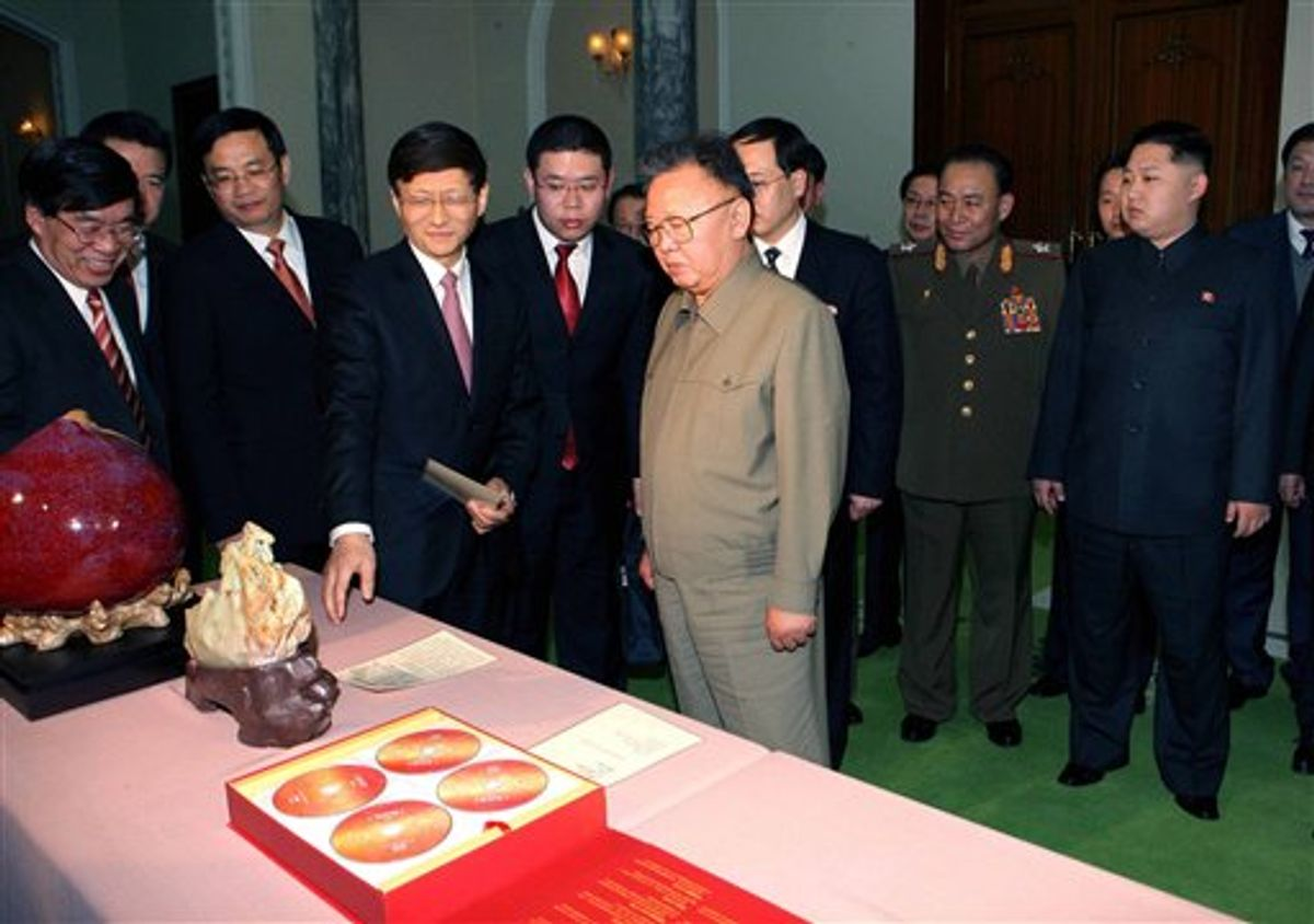In this photo released by Korean Central News Agency via Korea News Service in Tokyo Tuesday, Feb. 15, 2011, North Korean leader Kim Jong Il, center right, looks at the gifts brought by visiting Chinese Minister of Public Security Meng Jianzhu, fourth left, in Pyongyang, North Korea, on Monday, Feb. 14, 2011. At right is Kim's son Kim Jong Un. (AP Photo/Korean Central News Agency via Korea News Service) JAPAN OUT                      (AP)