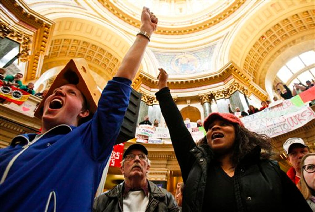 Sean Conard, left, of Green Bay, Wis., and Shyla Deacon of Milwaukee cheer during protests at the state Capitol in Madison, Wis., Saturday, Feb. 26, 2011. Protests to the governor's bill to eliminate collective bargaining rights for many state workers are in their 12th day. (AP Photo/Andy Manis) (AP)