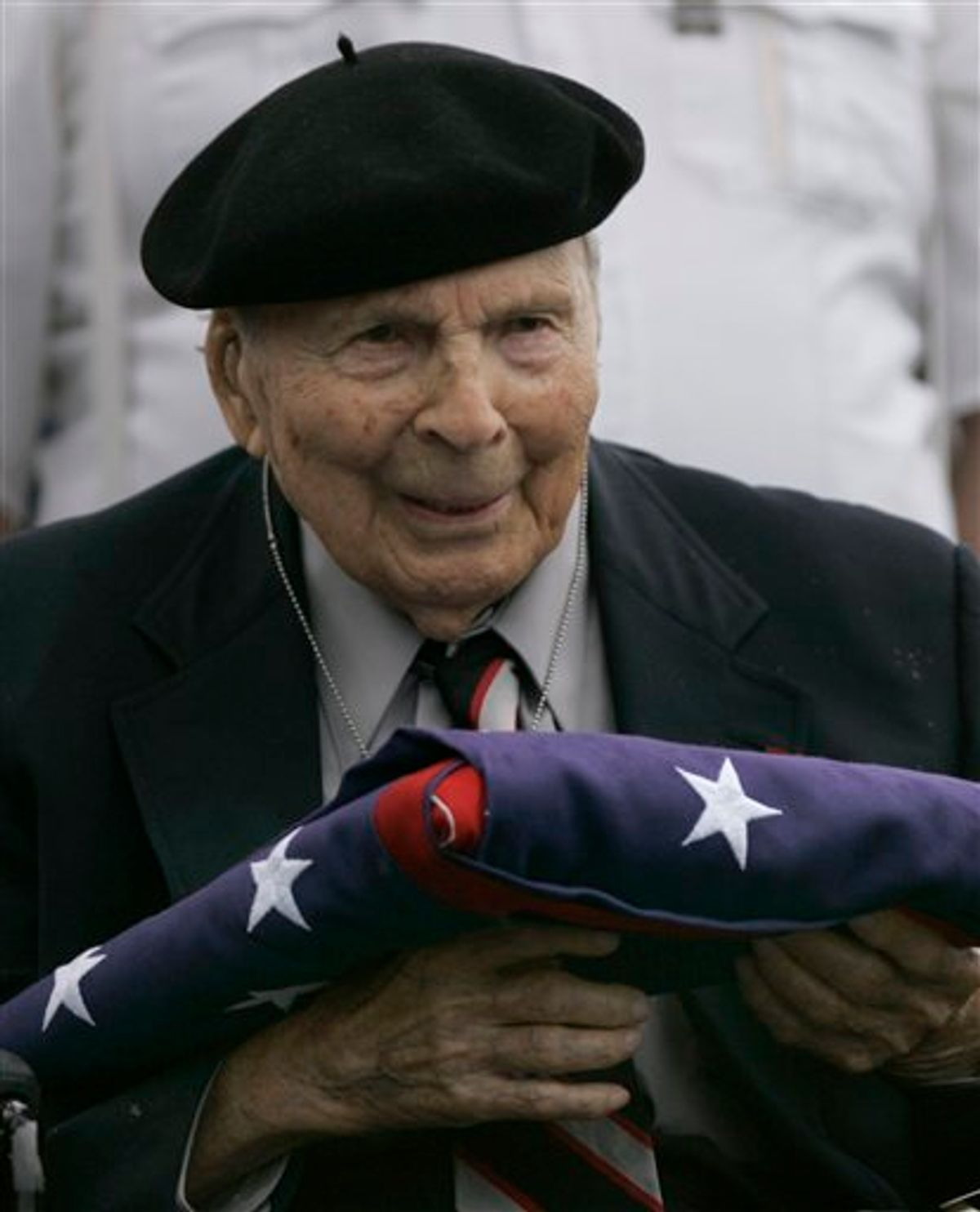 FILE -- In a May 26, 2008 file photo Frank Buckles receives an American flag during Memorial Day activities at the National World War I Museum in Kansas City, Mo. Biographer and family spokesman David DeJonge said in a statement that Frank Woodruff Buckles died early Sunday, Feb. 27, 2011 of natural causes in his home in Charles Town, W.Va.   (AP Photo/Charlie Riedel) (AP)