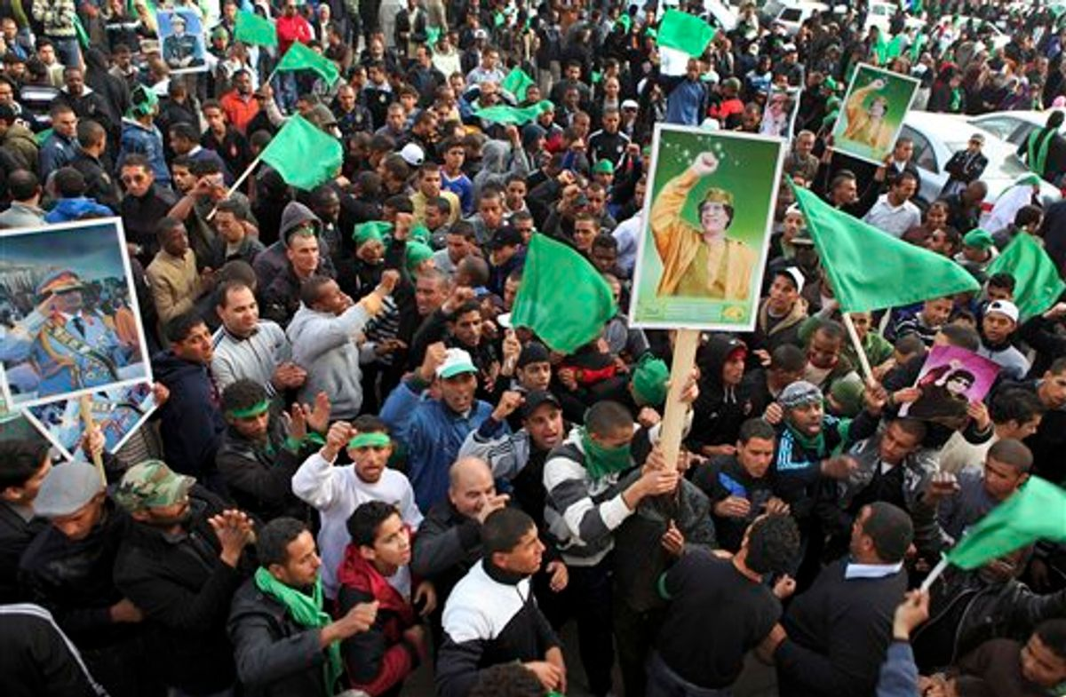 Pro-Gadhafi supporters gather in Green Square after traditional Friday prayers in Tripoli, Libya, Friday, Feb. 18, 2011. Protesters battled with security forces for control of neighborhoods Friday in eastern Libya where dozens have reportedly been killed in two days of clashes, as a leadership congress controlled by Moammar Gadhafi pledged a change in government adminstrators, trying to ease demonstrations demanding the longtime leader's ouster. (AP Photo/Abdel Meguid al-Fergany) (AP)