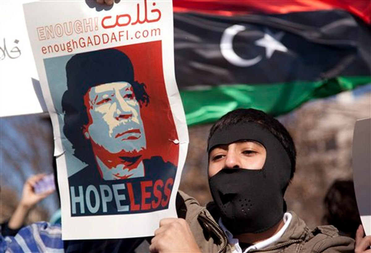Demonstrators gather near the White House in Washington in a show of solidarity with the Libyan protestors on Saturday, Feb. 19, 2011.  Moammar Gadhafi's forces fired on mourners leaving a funeral for protesters Saturday in the eastern city of Benghazi, killing at least 15 people and wounding scores more as the regime tried to squelch calls for an end to the ruler's 42-year grip on power.  (AP Photo/Evan Vucci) (AP)