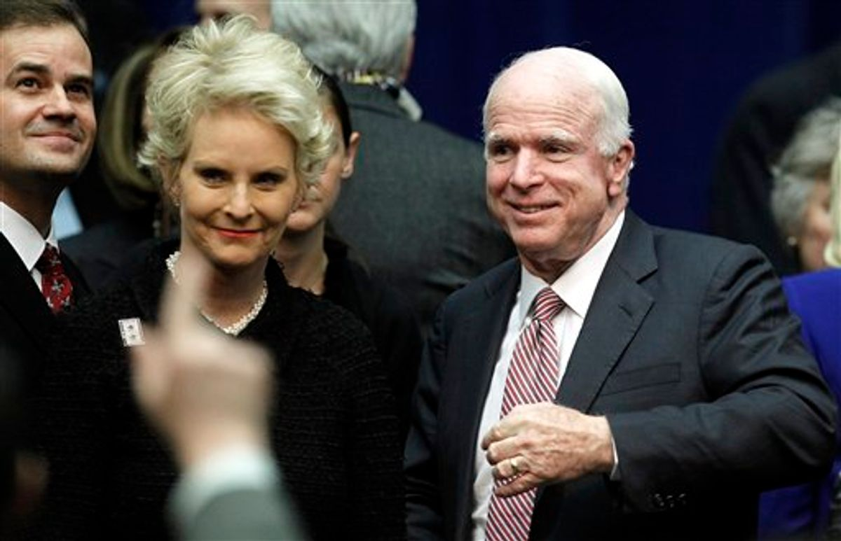 Sen. John McCain, R-Ariz., and wife Cindy arrive at a memorial service for the victims of Saturday's shootings at McKale Center on the University of Arizona campus Wednesday, Jan. 12, 2011, in Tucson, Ariz. (AP Photo/Chris Carlson) (AP)