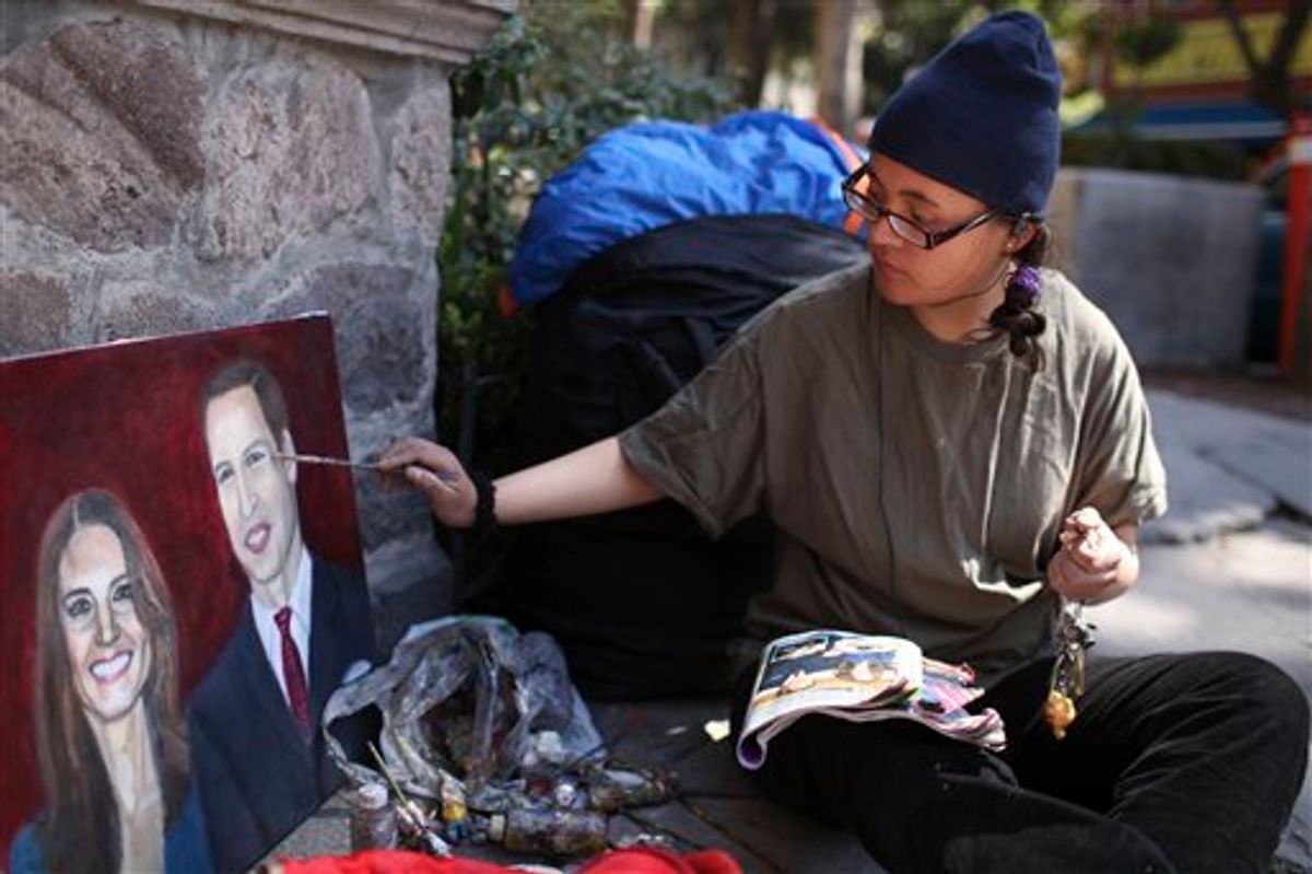 Estibalis Chavez paints a portrait of Britain's Prince William and Kate Middleton in front of the British Embassy in Mexico City, Friday Feb. 18, 2011.  Chavez, 19, who says she has a childhood dream to attend a royal wedding, claims she has been on a hunger strike for nine days and will continue her fast camped out in front of the embassy until she gets an invitation to attend the royal wedding of William and Kate.  According to a statement from the British embassy in Mexico, Buckingham Palace is aware of Chavez's hunger strike but no invitation will be extended to her. (AP Photo/Alexandre Meneghini)  (AP)