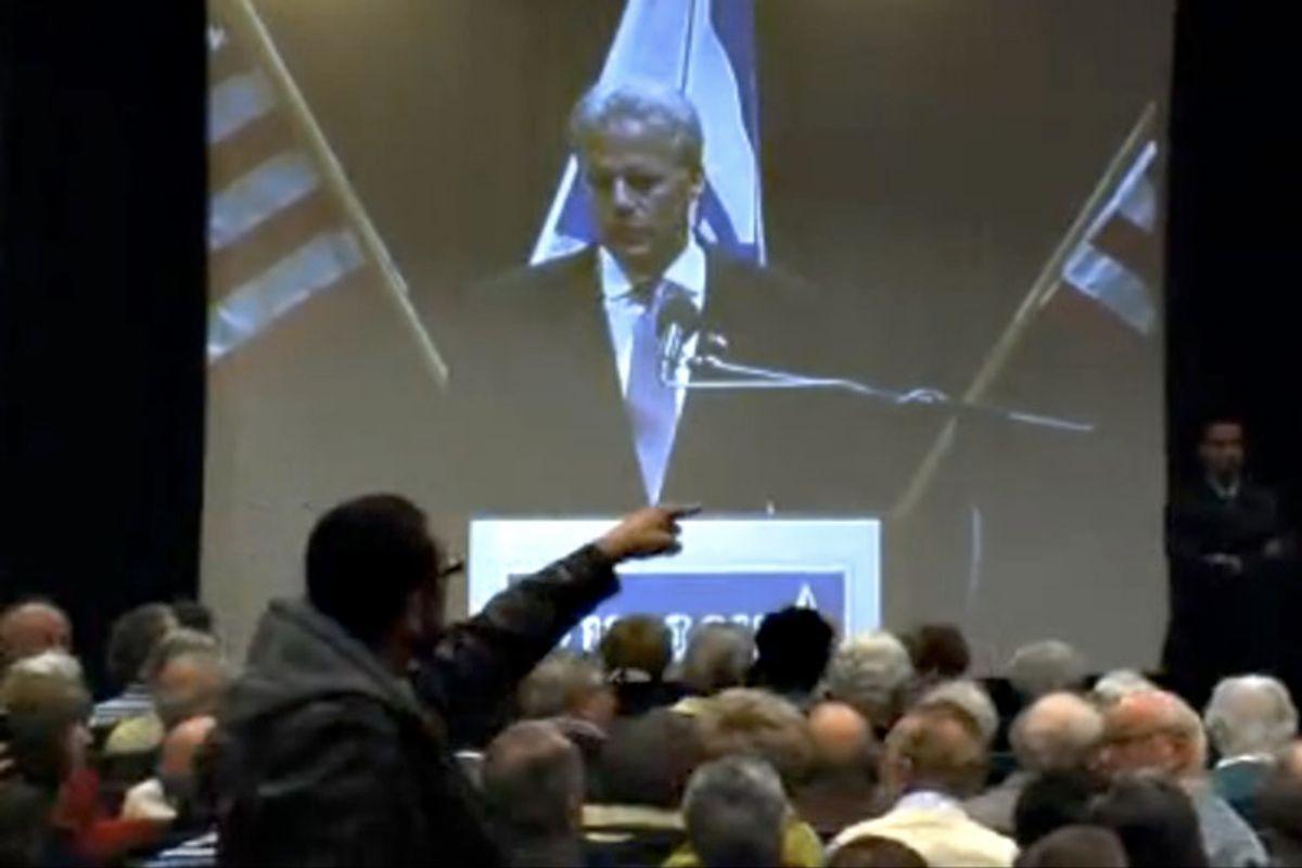 A protester interrupts Israeli Ambassador Michael Oren at University of California at Irvine in February 2010.