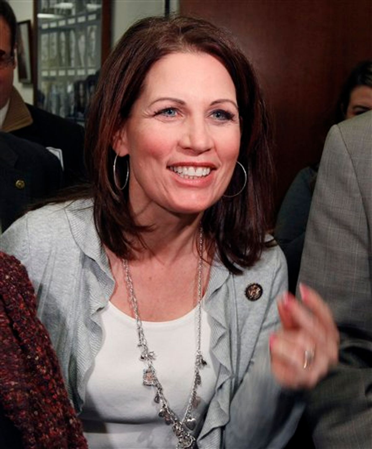 """Rep. Michele Bachmann, R-Minn., speaks during the """"Hot Dish Off,"""" cooking contest in the office of Sen. Al Franken, D-Minn., on Capitol Hill in Washington, Wednesday, Jan. 26, 2011. (AP Photo/Alex Brandon) (AP)"""