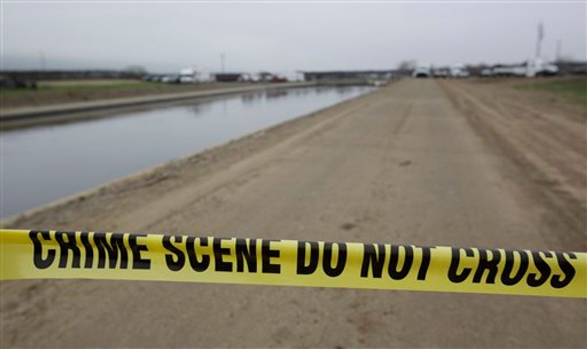 Crime scene tape is shown at a canal in Patterson, Calif., Friday, Jan. 28, 2011. The Toyota Corolla belonging to Jose Rodriguez, who is suspected of kidnapping 4-year-old Juliani Cardenas, was pulled up from the canal.  (AP Photo/Paul Sakuma) (AP)