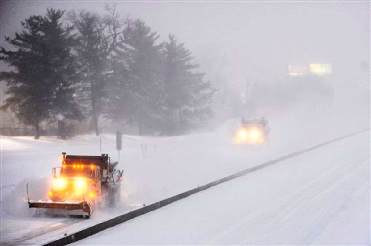 Snow plows drive westbound along Interstate 70 Tuesday, Feb. 1, 2011 in Columbia, Mo. Earlier in the day, the Missouri Department of Transportation closed Interstate 70 between Kansas City and St. Louis because of the storm, which is expected to dump between 18 and 24 inches of snow across mid-Missouri. (AP Photo/The Columbia Daily Tribune, Joshua A. Bickel)   (AP)