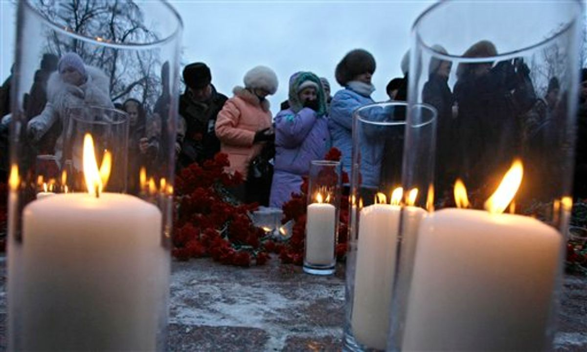 People light candles and place flowers, mourning victims of the  deadly bombing at a Moscow airport during a commemoration rally in downtown Moscow, Russia, Thursday, Jan. 27, 2011. A suicide bomber set off an explosion that ripped through Moscow's busiest airport on Monday, killing dozens of people and wounding more than a hundred. (AP Photo/Misha Japaridze)  (AP)
