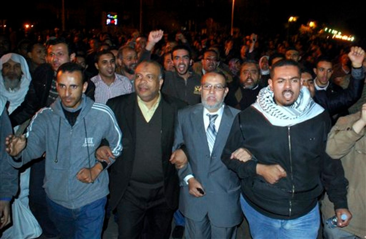 ** CORRECTS AFFILIATION TO MUSLIM BROTHERHOOD INSTEAD OF EGYPTIAN BROTHERHOOD ** Muslim Brotherhood seniors Essam el-Erian, centre right, and Saad el-Katatni, centre left, take part in a protest in Cairo, Egypt, Sunday, Jan. 30, 2011.  (AP Photo/Mohammed Abu Zaid)  (AP)
