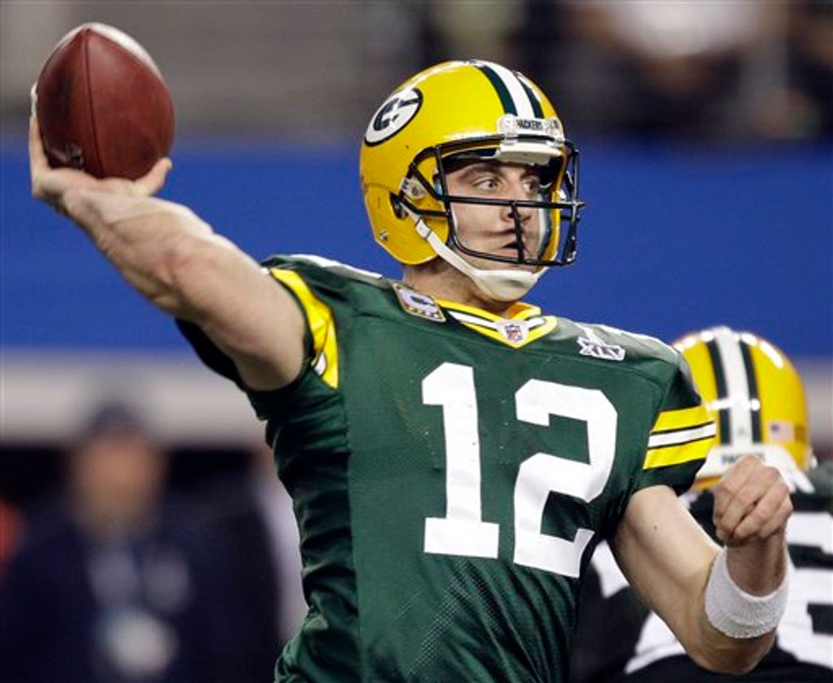 Green Bay Packers' Aaron Rodgers throws a touchdown pass during the second half of the NFL football Super Bowl XLV game against the Pittsburgh Steelers Sunday, Feb. 6, 2011, in Arlington, Texas. (AP Photo/Chris O'Meara) (AP)