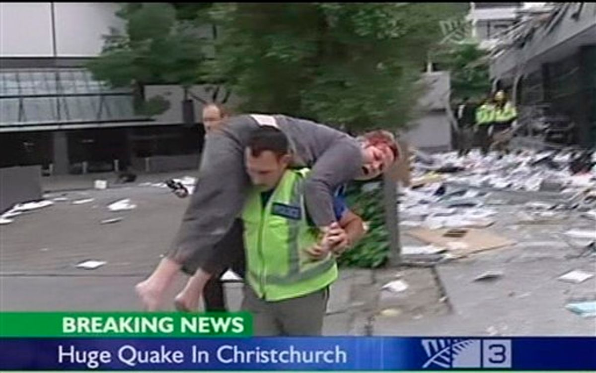 In this image made from video run by New Zealand's TV3, an injured person is carried on a street in Christchurch, New Zealand Tuesday, Feb. 22, 2011 after a 6.3-magnitude earthquake rocked the city. (AP Photo/TV3 via Associated Press Television News) NEW ZEALAND OUT, TV OUT  (AP)