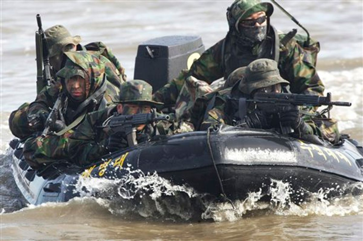 FILE - In this Feb. 25, 2011 file photo, South Korean marines on an inflatable boat aim their machine guns during a military exercise to prepare for a possible North Korea's surprise attack on the Han River in Gimpo, South Korea. North Korea's military threatened Sunday, Feb. 27, 2011 to fire at South Korea, as Seoul prepared to start annual joint drills with U.S. troops, maneuvers Pyongyang says are a rehearsal for an invasion. (AP Photo/Ahn Young-joon, File) (AP)