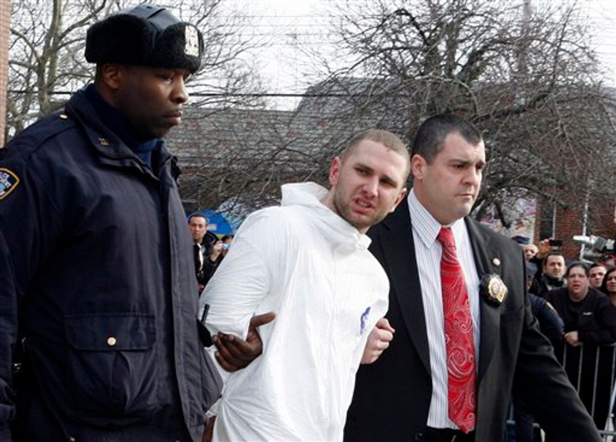 Maksim Gelman, of Brooklyn, who is accused of going on a 28-hour stabbing rampage through New York City, center, is lead by officers outside the 61st Precinct in the Brooklyn borough of New York Sunday, Feb. 13, 2011. (AP Photo/David Karp) (AP)